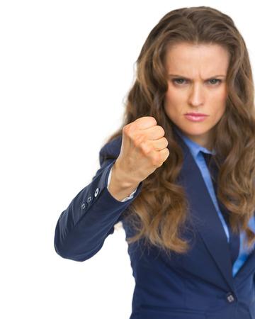 Mujer de negocios enojado amenaza con el puño Foto de archivo - 22665530