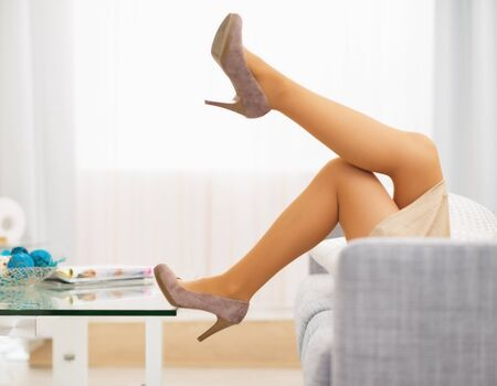 Closeup on leg of young housewife laying on divan Stock Photo - 22641525