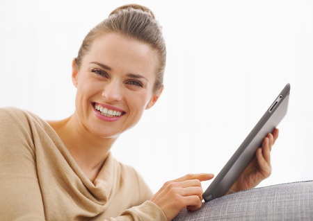 topicality: Smiling young woman using tablet pc