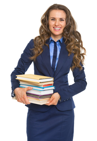 Smiling business woman holding stack of books photo