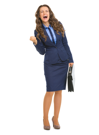 fist pump: Full length portrait of happy business woman with briefcase making fist pump gesture Stock Photo