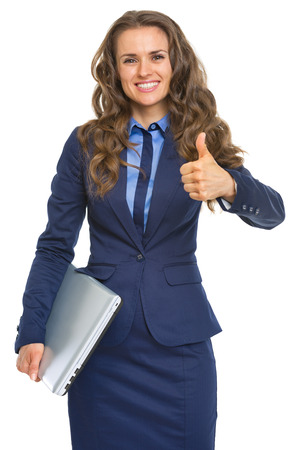 topicality: Portrait of smiling business woman with laptop showing thumbs up