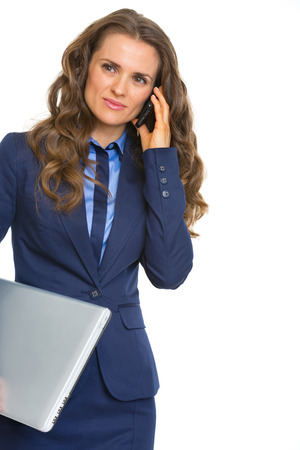 topicality: Business woman with laptop talking cell phone