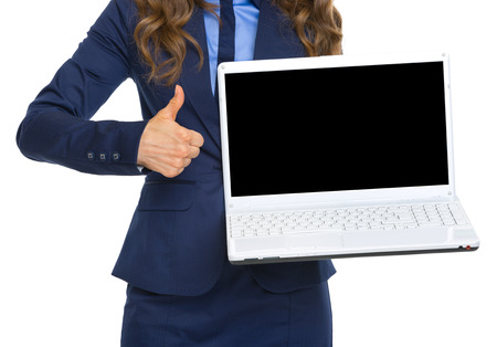 topicality: Closeup on business woman showing laptop blank screen and thumbs up Stock Photo
