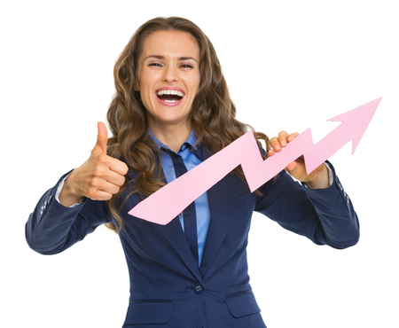 Smiling business woman showing graph arrow going up and thumbs up photo