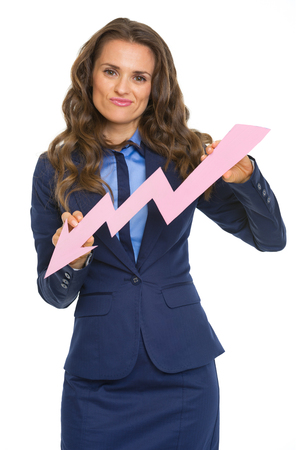 disquieted: Concerned business woman showing graph arrow going down Stock Photo