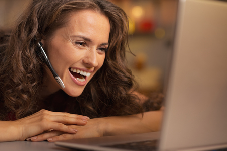 Happy young woman having christmas video chat on laptop Stock Photo - 22876533