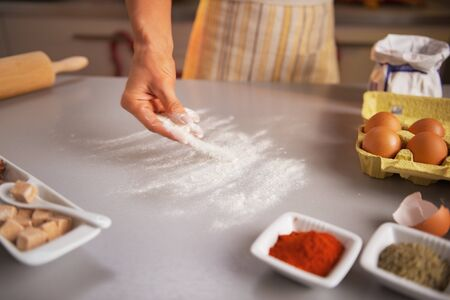 Motion blurred closeup on housewife sprinkling flour on table Stock Photo - 23533298