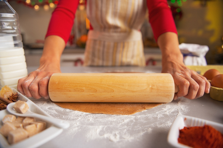 Closeup on housewife rolling out dough with rolling pin Stock Photo - 23533302