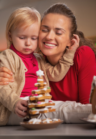 Portrait of happy mother and baby and cookie christmas tree Stock Photo - 23533500