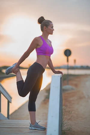 Fitness young woman stretching outdoors in the evening Stock Photo - 23537180