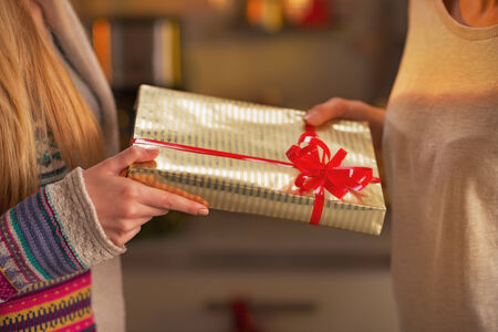 Closeup on two girlfriends exchanging christmas presents Stock Photo