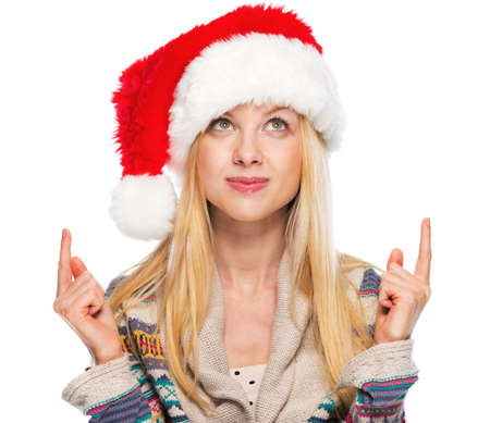 Portrait of happy teenage girl in santa hat pointing on copy space Stock Photo - 24293488