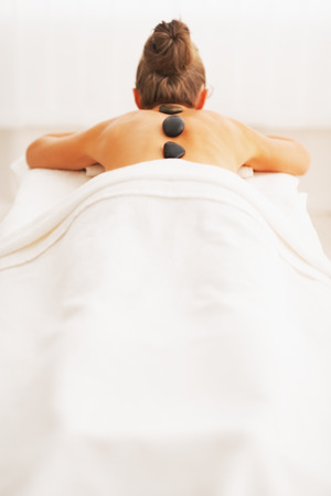 Young woman receiving hot stone massage  rear view Stock Photo - 24490626