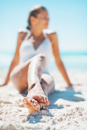 Closeup on young woman sitting on beach Stock Photo - 24773533