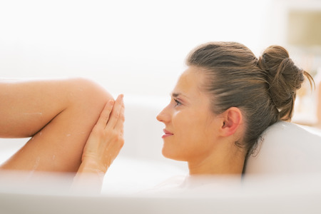 hygienics: Young woman washing in bathtub Stock Photo