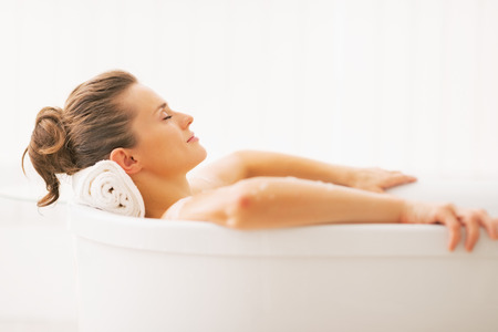 bathing women: Portrait of young woman relaxing in bathtub Stock Photo