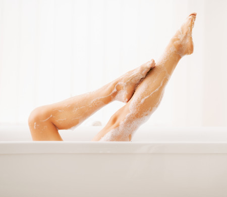 young woman legs up: Closeup on legs of young woman in bathtub
