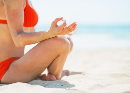 Closeup on young woman meditating on beach Stock Photo - 24913624