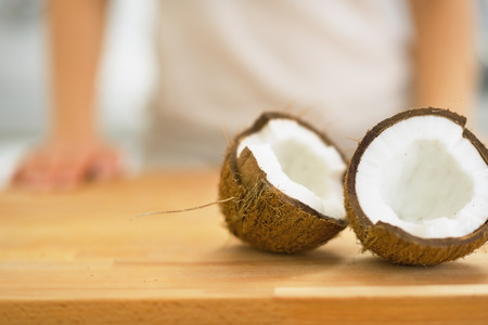 Closeup on coconut slices on cutting board photo