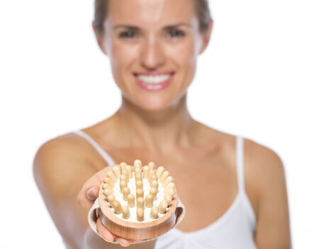 massager: Closeup on young woman showing massager Stock Photo