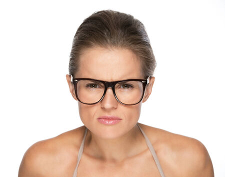 attentively: Young woman in eyeglasses looking attentively in camera Stock Photo