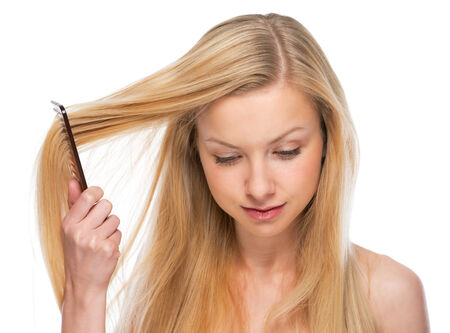 Young woman combing hair photo