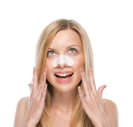 Happy young woman with clear-up strips on nose
