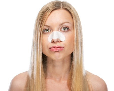 disquieted: Concerned young woman with clear-up strips on nose