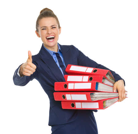 Smiling business woman with stack of documents showing thumbs up photo