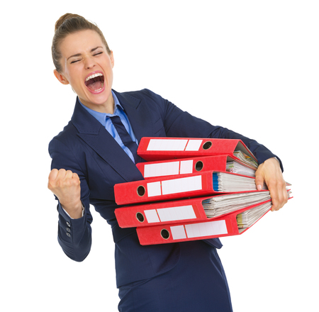 attainment: Smiling business woman with stack of documents making fist pump gesture Stock Photo