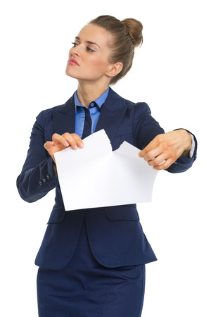 displeased: Displeased business woman tearing documents