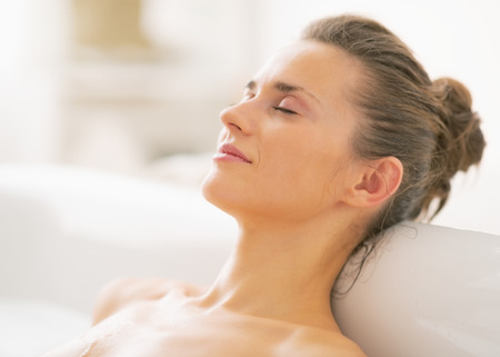 woman relaxing: Portrait of relaxed young woman in bathtub Stock Photo