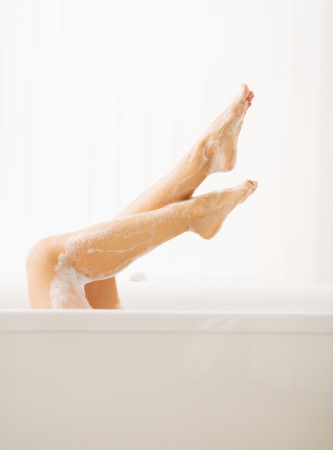 young woman legs up: Closeup on young woman in bathtub showing legs
