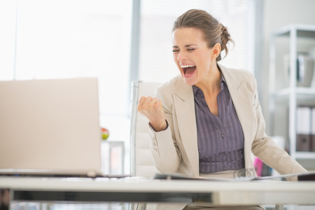 rejoicing: Happy business woman in office rejoicing success