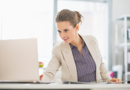 topicality: Business woman working with laptop in office
