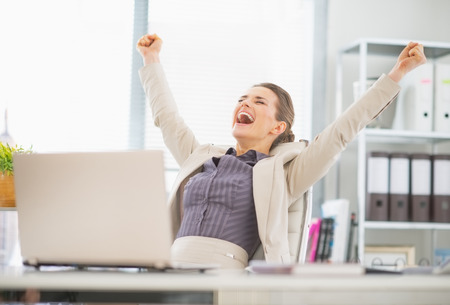 rejoicing: Portrait of happy business woman in office rejoicing success Stock Photo