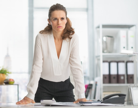 disquieted: Concerned modern business woman in office Stock Photo