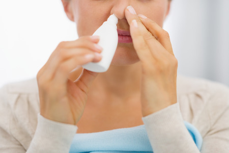 Closeup on young woman using nose drops Stock Photo - 26854775