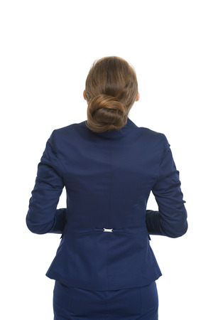 Business woman looking up on copy space. rear view