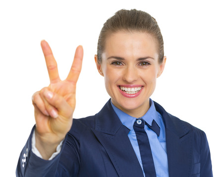 Happy business woman showing victory gesture photo