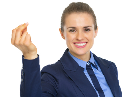 Portrait of smiling business woman snapping with fingers photo