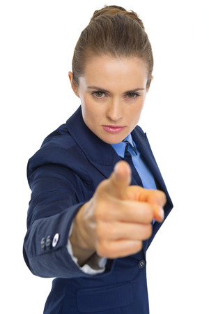 Angry business woman pointing in camera