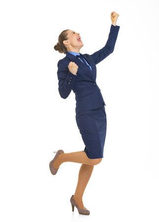 Full length portrait of happy business woman rejoicing success