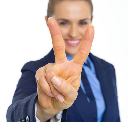 Closeup on happy business woman showing victory gesture photo