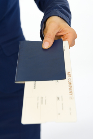Closeup on business woman giving passport and ticket photo