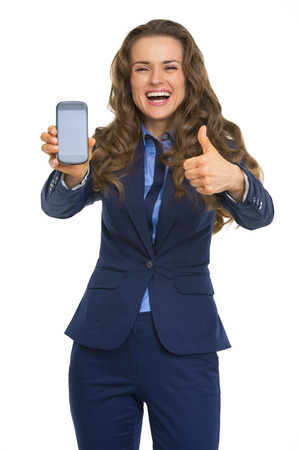 Happy business woman showing phone and thumbs up photo