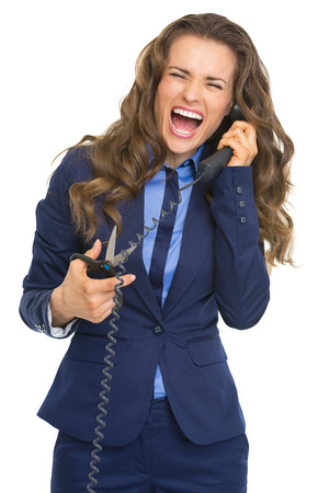 Business woman cutting phone handset with scissors photo