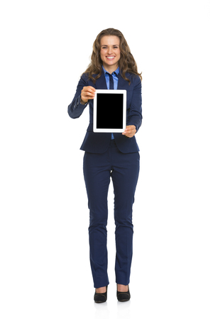 topicality: Full length portrait of business woman showing tablet pc blank screen