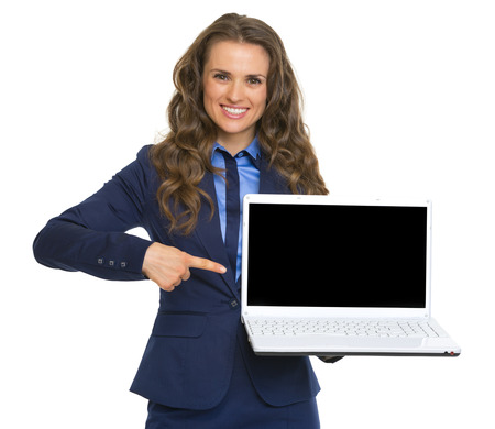 Happy business woman pointing on laptop blank screen Stock Photo